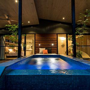 Pool at night at villa