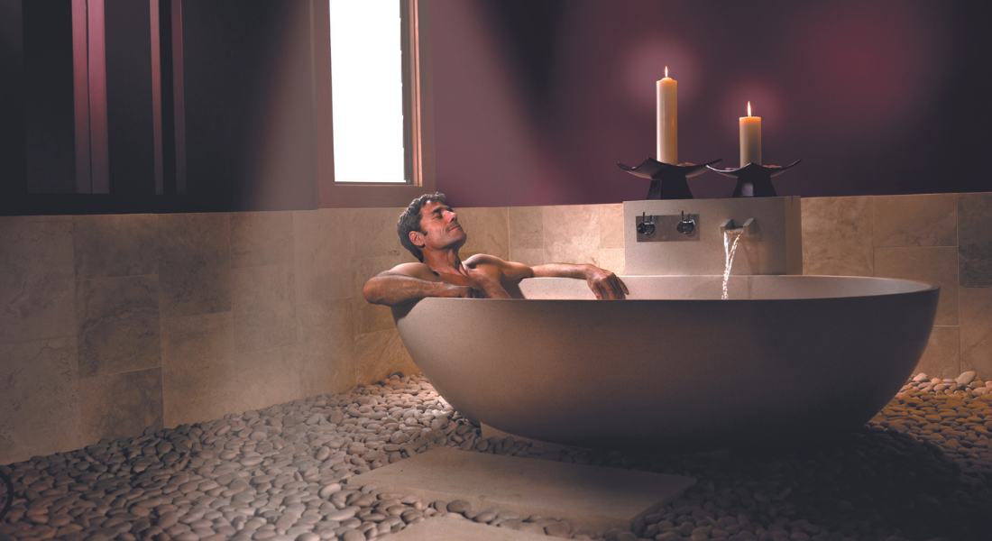man relaxes in soothing bath
